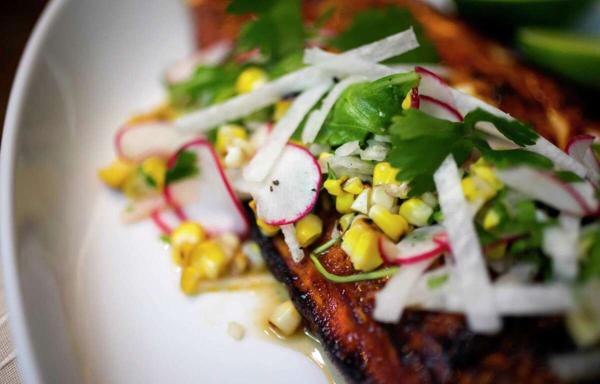 Wood-grilled redfish with cascabel salsa, roasted corn, jicama and lime oil at TRIBUTE, the new restaurant at the Houstonian Hotel, Club & Spa.