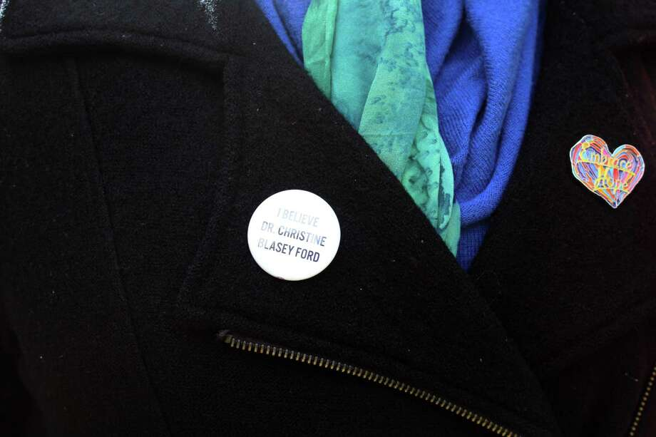 """One attendee of the Democratic Blue Wave Rally in Darien wore an """"I Believe Dr. Christine Blasey Ford"""" pin. Taken Oct. 21 Photo: /Lynandro Simmons /Hearst Connecticut Media"""