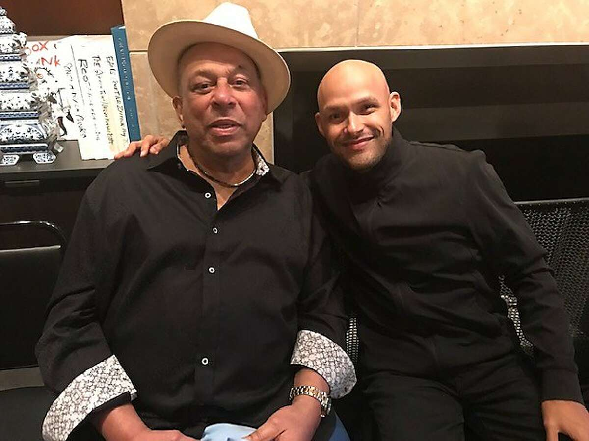 Giants great Orlando Cepeda and Miguel Zenon at Zenon's good-bye party