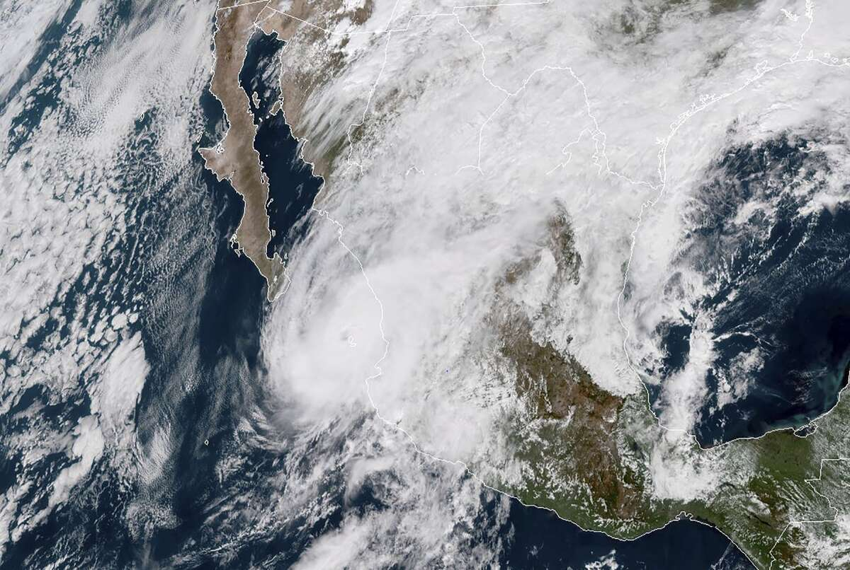 This NOAA/RAMMB satellite handout image taken AT 17:30 UTC on October 23, 2018 shows Hurricane Willa at Mexico's Pacific coast. - Mexico braced October 23, 2018 for the impact of Hurricane Willa as the Category 3 storm barreled toward its Pacific Coast with what forecasters warned would be potentially deadly force. Willa was a maximum Category 5 hurricane on October 22, 2018, but lost strength as it moved toward landfall -- expected on Tuesday afternoon or evening, the US National Hurricane Center said in its 1500 GMT update. Nevertheless, the NHC warned,