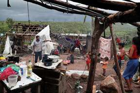 A family works to put their home back in order in the aftermath of Hurricane Willa, in Escuinapa, Mexico, Wednesday, Oct. 24, 2018. Emergency workers on Wednesday were struggling to reach beach towns left incommunicado by a blow from Willa.