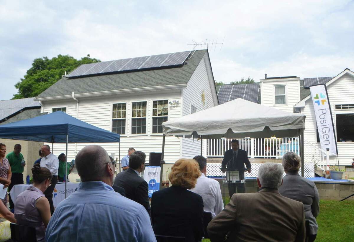 An audience on hand in July 2015 to hear about a Connecticut Green Bank-financed residential solar installation in Bridgeport, Conn.