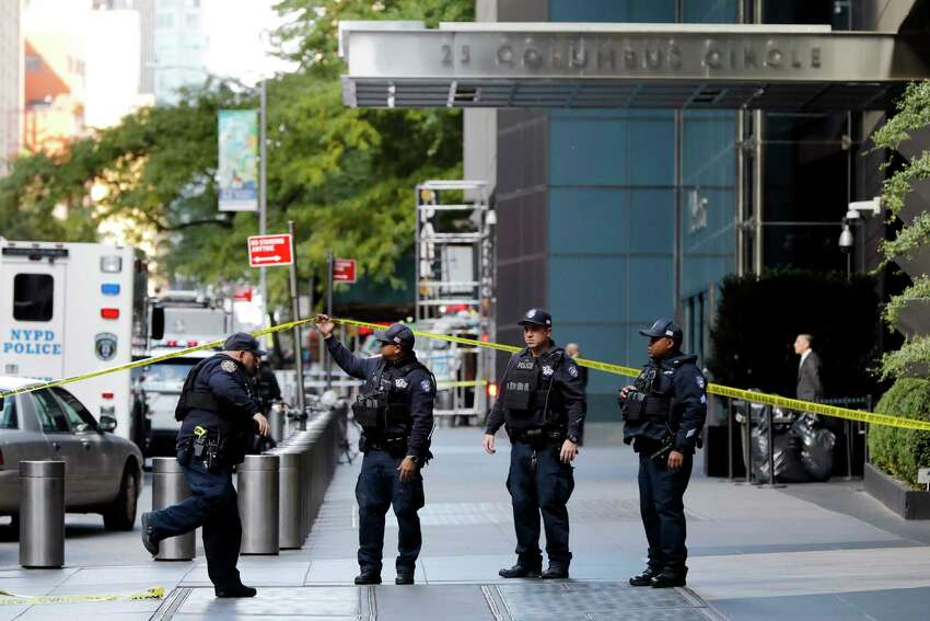 New York City Police Dept. officers arrive outside the Time Warner Center, in New York, Wednesday, Oct. 24, 2018. A police bomb squad was sent to CNN's offices in New York City and the newsroom was evacuated because of a suspicious package.
