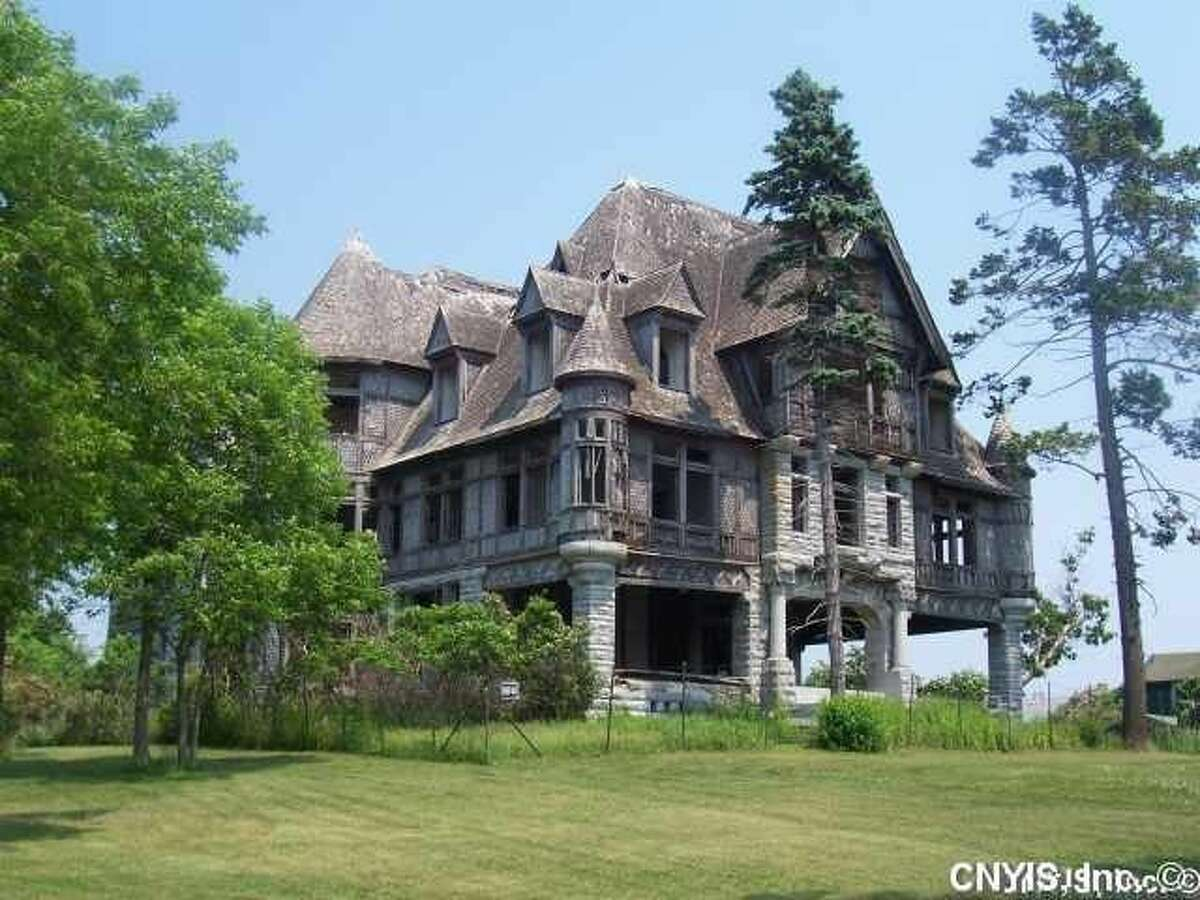 An abandoned villa on Carleton Island is listed for $495,000. The structure hasn't been lived in for over 70 years and requires millions in restoration costs.