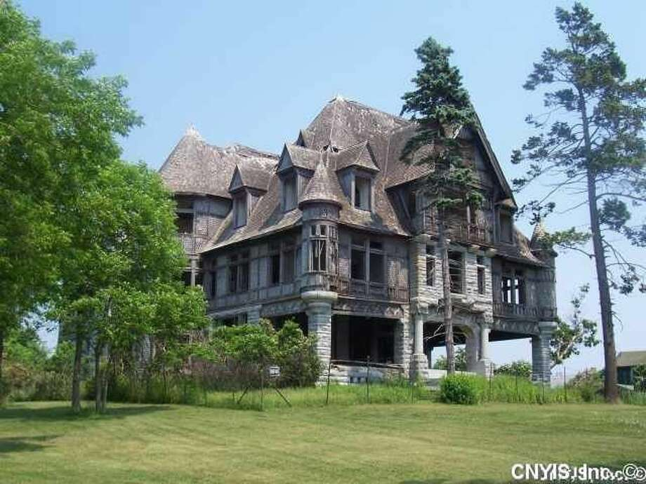 An abandoned villa on Carleton Island is listed for $495,000. The structure hasn't been lived in for over 70 years and requires millions in restoration costs. Photo: Realtor.com