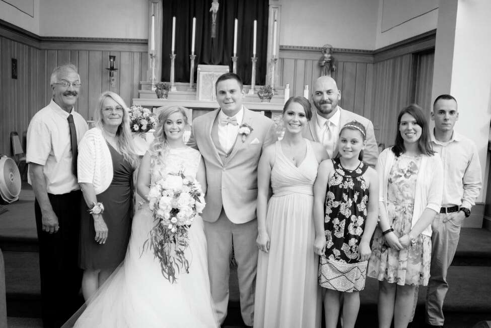 The Steenburg family, including Rich's wife and the youngest brother Eric's girlfriend, at Axel's wedding in June 2018.