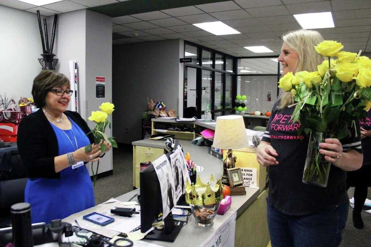 Flowers of Kingwood Owner Robin Martinez delivered roses to Kingwood Park High School.
