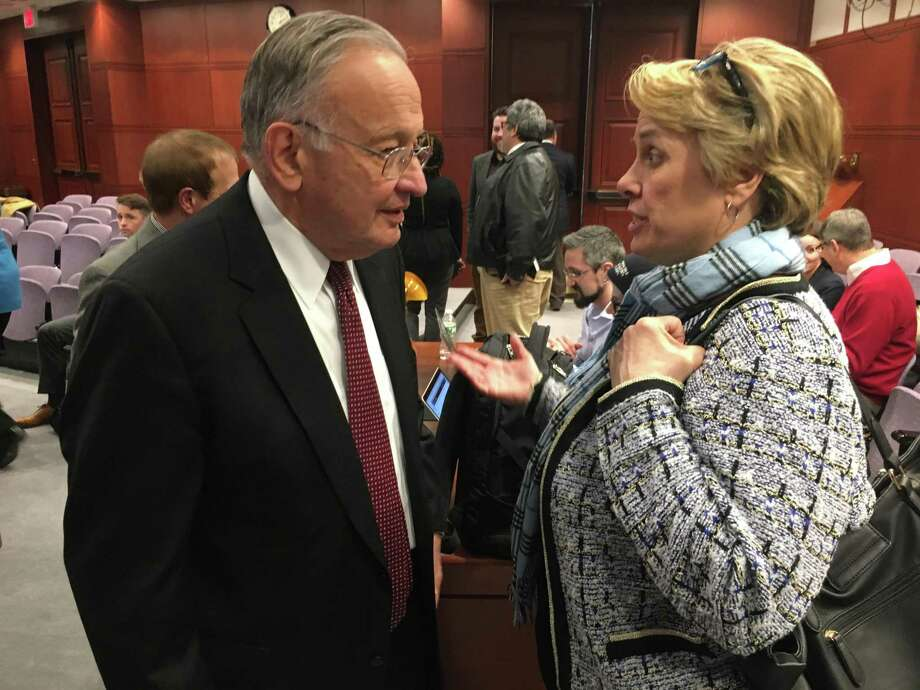 Lori Pelletier, right, president of the state AFL-CIO, talked with Robert Patricelli, co-chairman of the state Commission on Fiscal Sustainability and Economic Growth, during a break in a public hearing on Feb. 9, 2018 at the state Capitol in Hartford. The commission proposed labor concessions and some changes that labor favored. Photo: Dan Haar / Hearst Connnecticut Media