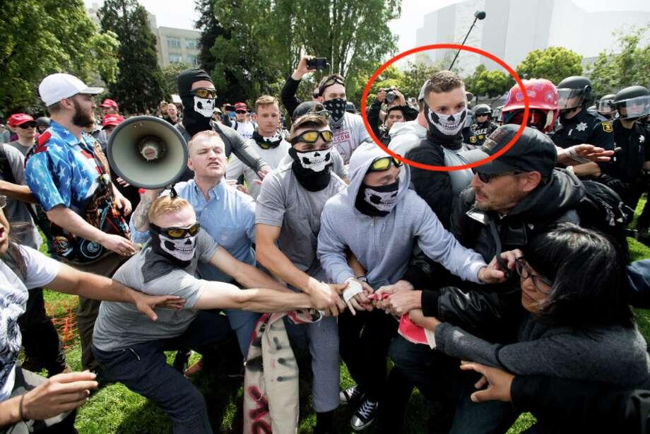 Robert Rundo, circled in red, faces off with counter-protesters during a conservative rally on Saturday, April 15, 2017, in Berkeley, Calf. Photo: Noah Berger / Special To The Chronicle