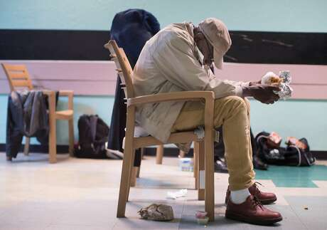 A homeless man spends the night in a chair at Mother Brown's on Friday, Oct. 5, 2018, in San Francisco, Calif. The drop-in center only has chairs, no beds or mats, so people have to sit in chairs all night. Photo: Paul Kuroda / Special To The Chronicle