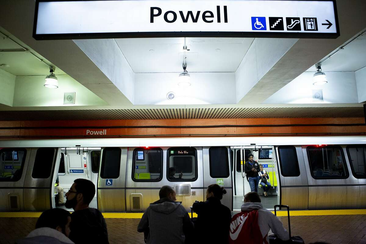 FILE -- A new BART train makes a stop at the Powell Street Station on Wednesday, Oct. 24, 2018, in San Francisco, Calif. BART's new trains are expected to improve on the noise issues riders have complained about over the years, with selected materials for the car chosen in order to dampen the noise. The transit agency has been working on creating a quieter experience for riders.