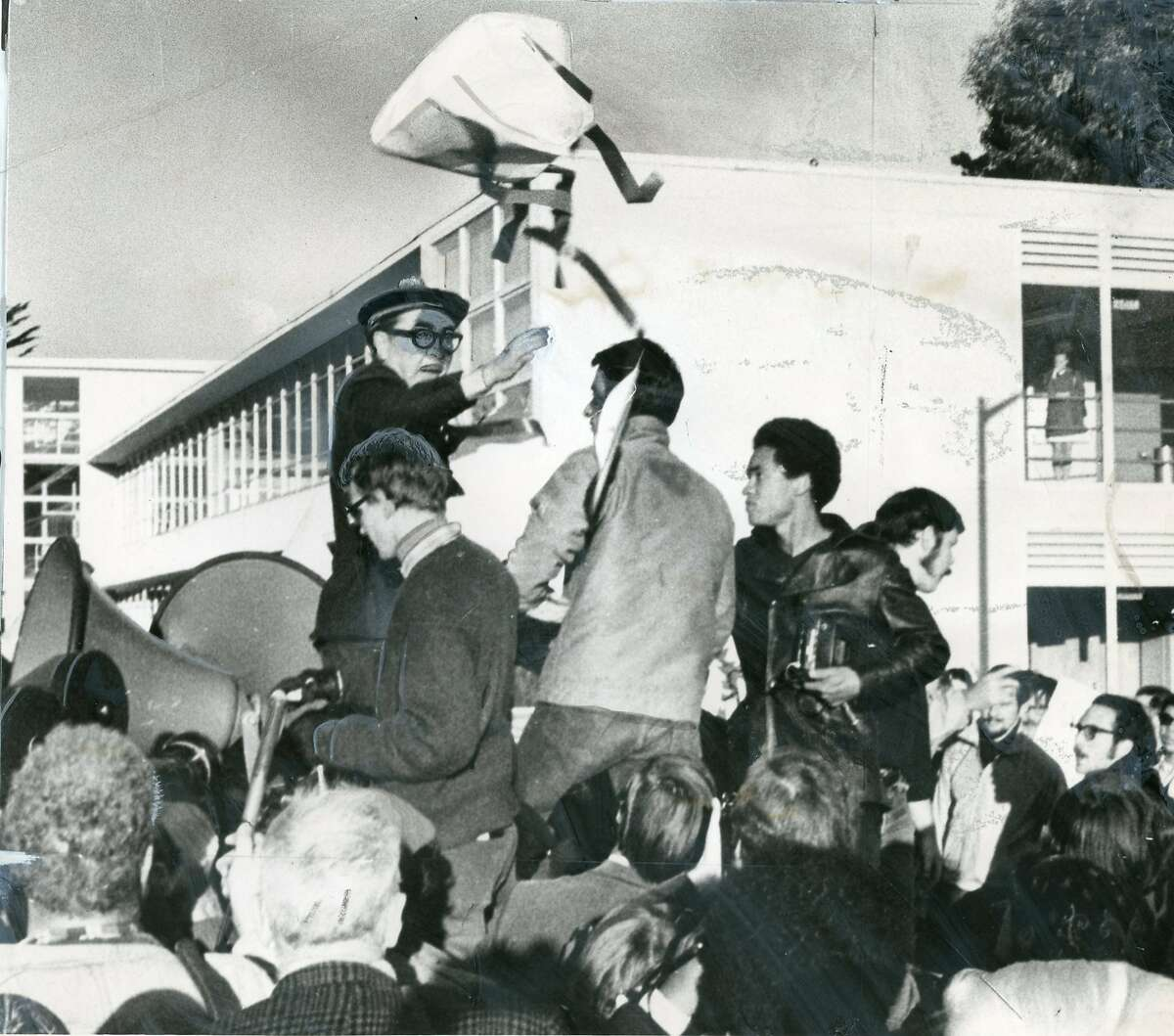 Students confront University President S.I. Hayakawa as he is on a truck during student demonstrations meant to shut San Francisco State college down during a strike, December 1, 1968 Photo ran 12/3/1968, P. 18