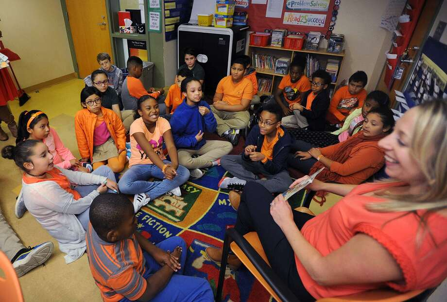 Students, teachers, and administrators wear orange as a sign of unity as 5th grade teacher Kristen Gill talks with her class about bullying at the Discovery Magnet Elementary School in Bridgeport, Conn. on Wednesday, October 24, 2018. Photo: Brian A. Pounds / Hearst Connecticut Media / Connecticut Post