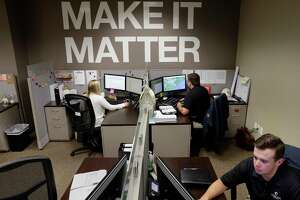 Kimberly Morrison, left, in thesSystems department along with Michael Smith and Cameron Milstead in the Aquisitions department at their fourth floor desks in the offices of LGI Homes Thursday, Sep. 6, 2018 in The Woodlands, TX.
