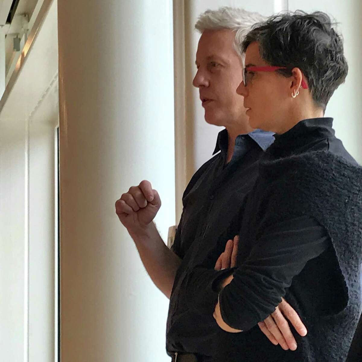 """Moody Center artist-in-residence Matthew Ritchie and San Francisco choreographer Hope Mohr confer during a moment of rehearsal for Saturday's performance, """"Dimensions Variable,"""" by Mohr's company within Ritchie's installation """"Demon in the Diagram."""""""