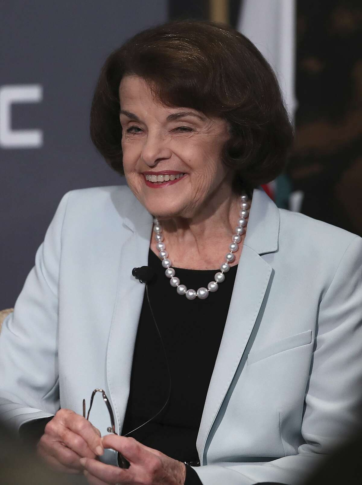California Sen. Dianne Feinstein, D-Calif., smiles while speaking to California Sen. Kevin de Leon, D-Los Angeles, during a debate on Wednesday, Oct. 17, 2018, in San Francisco. Feinstein shared the stage with an opponent for the first time since 2000 when she debated state Sen. Kevin de Leon.The two Democrats are facing off in the Nov. 6 election. (AP Photo/Ben Margot)