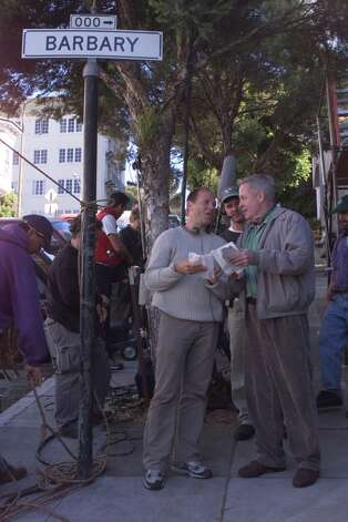 "Director Pierre Gang (tan sweater) author Armistead Maupin chat while filming location shots for the third serial based on Maupin's ""Tales of the City"" in SF. Photo: JERRY TELFER/SFC"