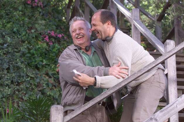 "Director Pierre Gang (tan sweater) author Armistead Maupin chat while filming location shots for the third serial based on Maupin's ""Tales of the City"" in SF. Photo: JERRY TELFER"