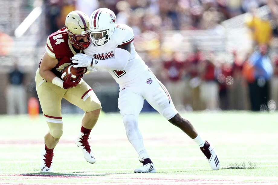 UMass's Brice McAllister tackles Boston College's Jake Burt at Alumni Stadium on September 1 in Chestnut Hill, Massachusetts. Photo: Maddie Meyer / Getty Images / 2018 Getty Images 2018 Getty Images