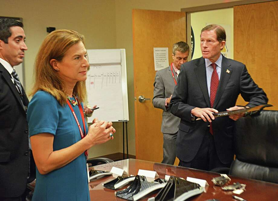 Lieutenant governor candidate Susan Bysiewicz, lef, in blue, and U.S. Sen. Richard Blumenthal, D-Connecticut, right, visited GKN Aerospace Services at 1000 Corporate Row, Cromwell, Wednesday morning. At far left is Sergio Morean, vice president and general manager, who conducted the walkthrough, which included a glimpse at the window frame and fan inlet case of the Lockheed Martin F-35, built by GKN. Photo: Cassandra Day / Hearst Connecticut Media / The Middletown Press