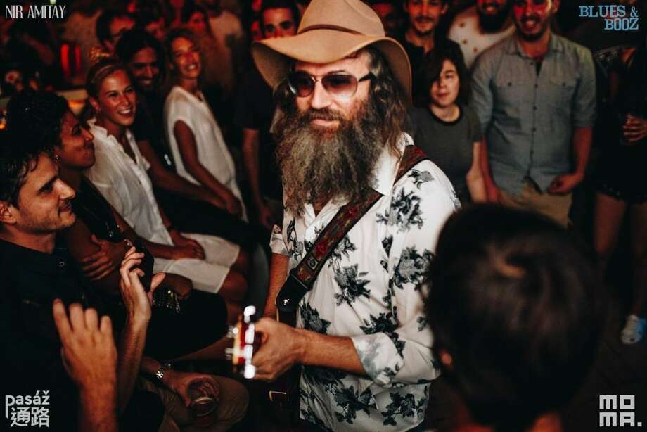Performer Lazer Lloyd crowd surfing at one of his concerts. Photo: Contributed Photo / Yocheved Seidman