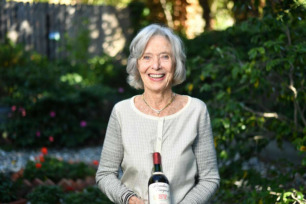 Joanne DePuy holds an old bottle of wine at the home of Dorothy Tchelistcheff in Napa, California on October 12, 2018.