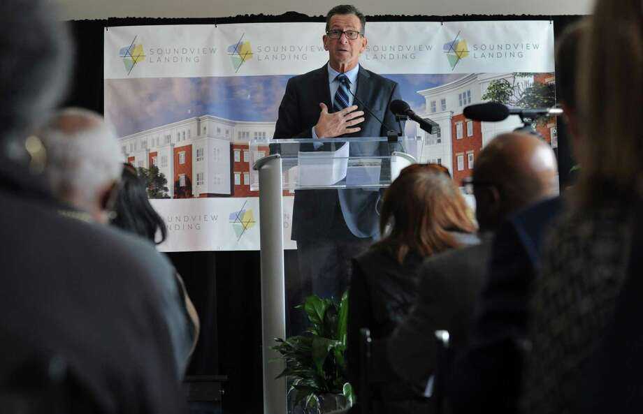 """Dignitaries including Connecticut Governor Dannel Malloy speak during a celebration of the completion of phase one of Soundview Landing Wednesday, October 24, 2018, in Norwalk, Conn. Connecticut's oldest public housing complex, Washington Village, has undergone a multi-million-dollar redevelopment and has been renamed """"Soundview Landing"""". Owned by the Norwalk Housing Authority, Washington Village was built in 1941 and sustained flood damage during Hurricane Sandy. Photo: Erik Trautmann / Hearst Connecticut Media / Norwalk Hour"""