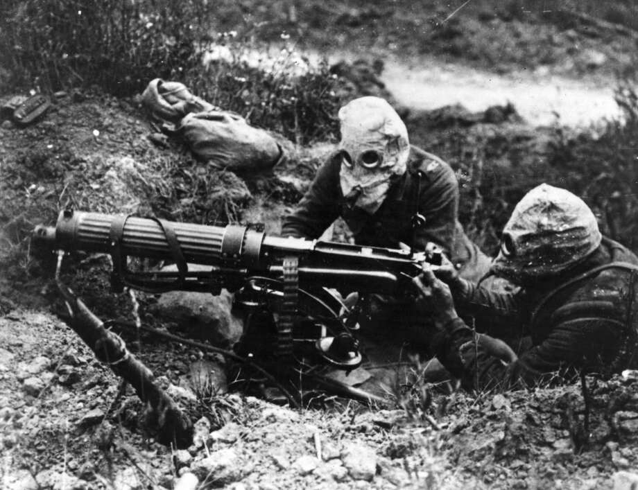 Gas-masked men of the British Machine Gun Corps with a Vickers machine gun during the first battle of the Somme.   (Photo by General Photographic Agency/Getty Images) Photo: General Photographic Agency/Getty Images