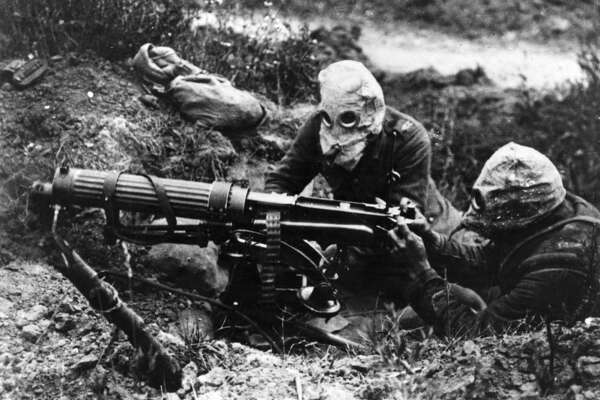 Gas-masked men of the British Machine Gun Corps with a Vickers machine gun during the first battle of the Somme. (Photo by General Photographic Agency/Getty Images)
