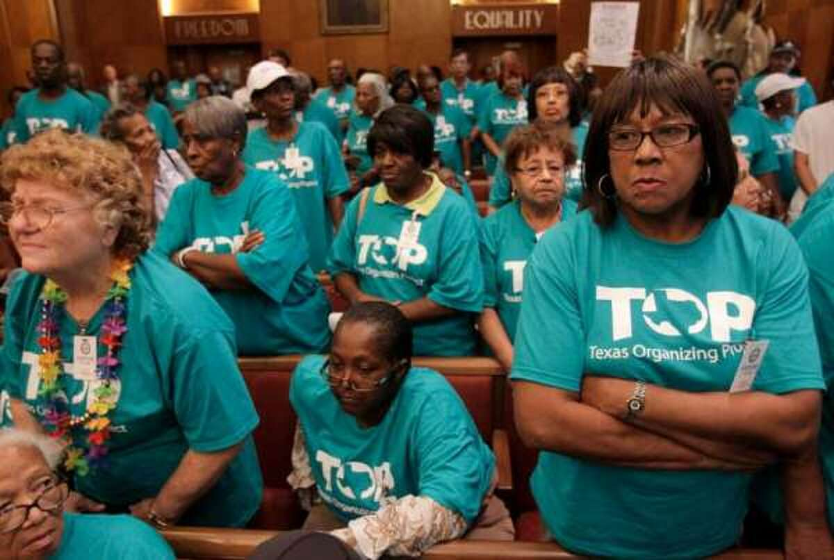 The Texas Organizing Project is a progressive non-profit. Members of the group have been prohibited from voting while wearing t-shirts like the ones pictured here.