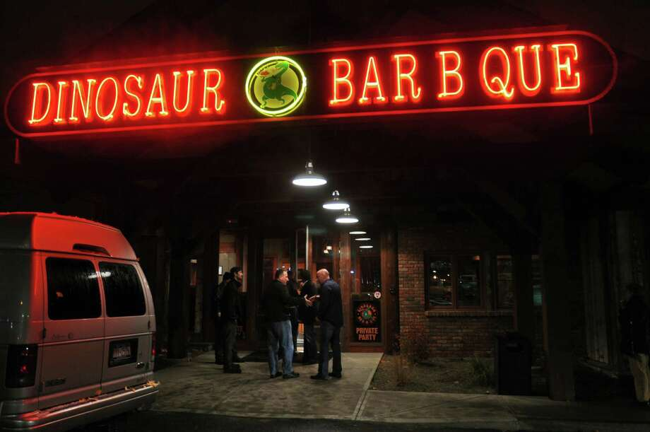 """Guests enter for a """"sneak peek"""" of the new Dinosaur Bar B Que in Troy, NY,  on  Monday evening November 8, 2010.   ( Philip Kamrass / Times Union ) Photo: Philip Kamrass / 00010956A"""