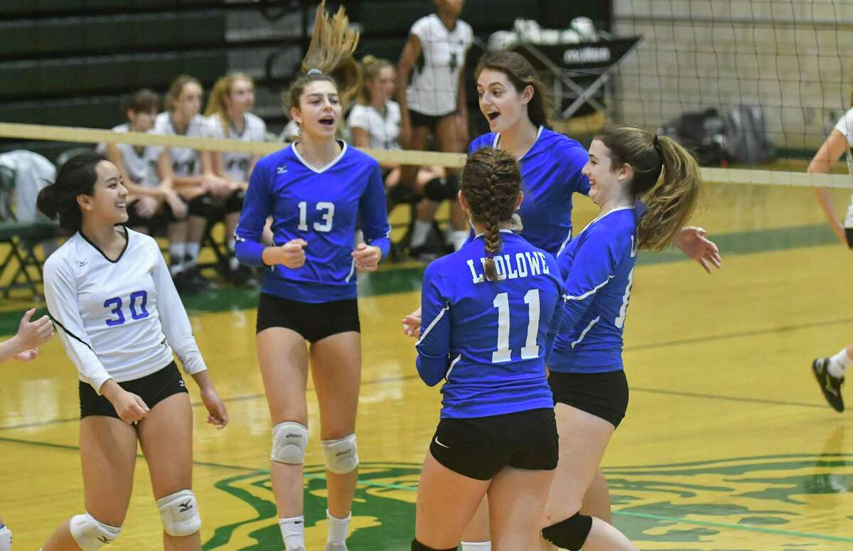 Members of the Fairfield Ludlowe volleyball team celebrate a Game 1 victory during a match against Norwalk on Wednesday.