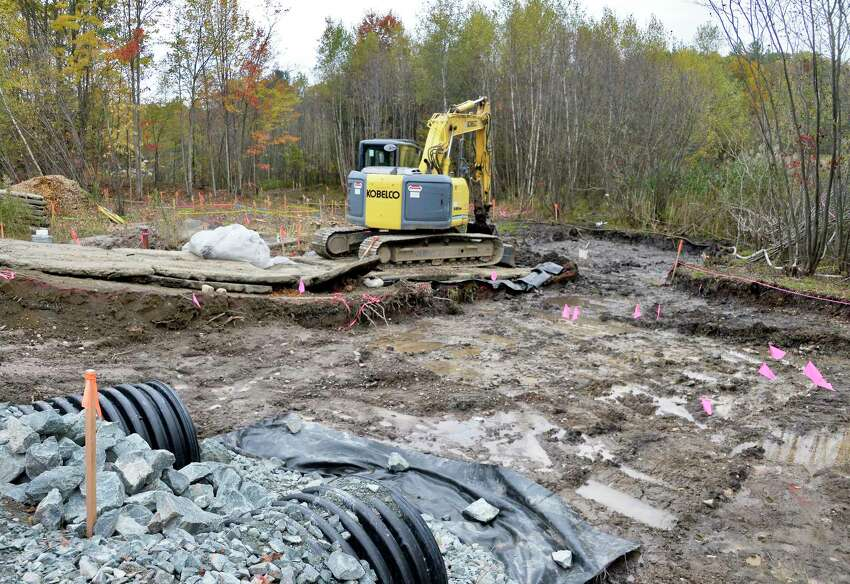 A drainage ditch, one of the headwaters of Little Thunder Creek, formerly T11A, a tributary of the Valatie Kill, is being worked on by crews at the Dewey Loeffel Landfill Superfund site in 2018 in Nassau. The Nassau Town Board named the tributary after a Anti-Rent War figure Little Thunder as a way to call attention to the creek and reclaim it.