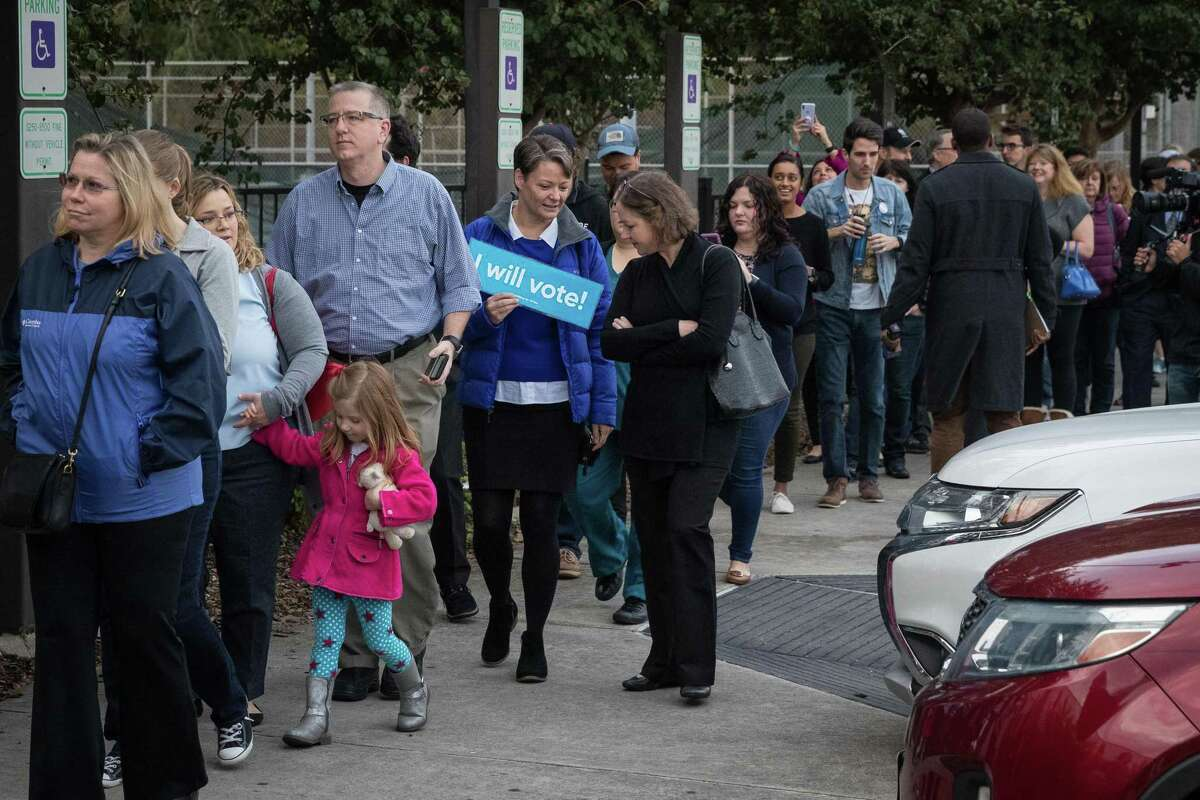 People wait in line to vote at a polling place on the first day of early voting on October 22, 2018 in Houston, Texas. Democratic Senate candidate Rep. Beto O'Rourke is running against Republican Sen. Ted Cruz in the midterm elections.
