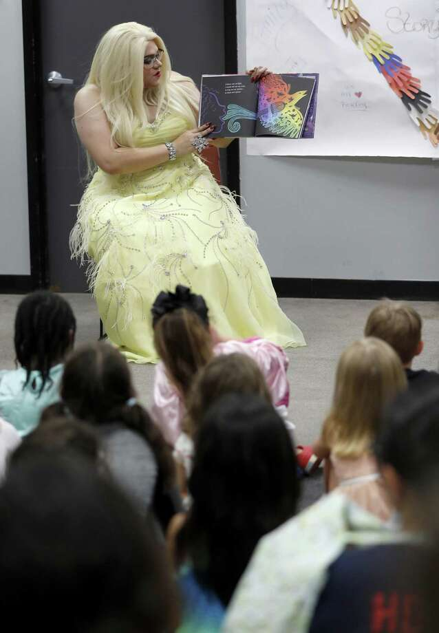 Tatiana reads a book to children during the monthly Drag Queen Story Time at Freed-Montrose Neighborhood Library, Saturday, September 29, 2018, in Houston. Saturday marked the one-year anniversary of the story hour, which happens on the last Saturday of every month. Photo: Karen Warren, Houston Chronicle / Staff Photographer / © 2018 Houston Chronicle