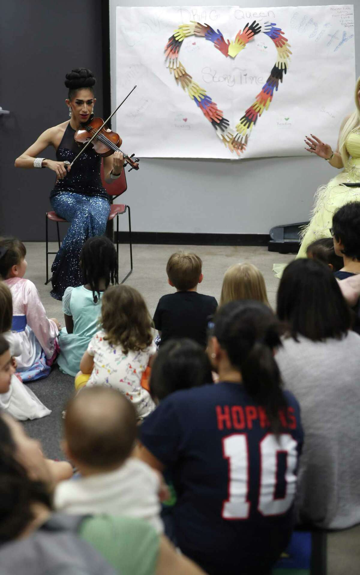 Angelina plays the violin for adults and children during the monthly Drag Queen Story Time at Freed-Montrose Neighborhood Library, Saturday, September 29, 2018, in Houston. Saturday marked the one-year anniversary of the story hour, which happens on the last Saturday of every month.