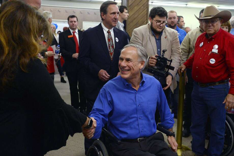 Gov. Greg Abbott greets supporters during a campaign stop at the Jefferson County Republican Party's office in Port Neches on Wednesday.   Photo taken Wednesday 10/24/18  Ryan Pelham/The Enterprise Photo: Ryan Pelham / The Enterprise / ©2018 The Beaumont Enterprise