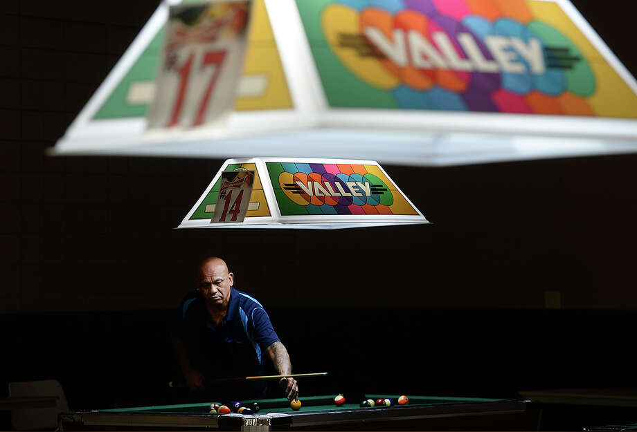 "David Martinez gets in some practice before competing in the Scotch Doubles during the American CueSports Alliance 2018 ACS Texas State Championships billiards tournament in Port Arthur. Over 40 billiards tables fill the Robert A. ""Bob"" Bowers Civic Center for the event, which opened Wednesday and continues through Sunday. The competition is free and open to the public, running from 10 a.m. - midnight through Saturday and 10 a.m. - 9 p.m. Sunday. Four hundred pool players from leagues across the state are joining in the annual compeition, which includes several team divisions and individual events. First place winners earn a free spot to the national 8-ball tournament held in May in Las Vegas. Photo taken Wednesday, October 24, 2018 Kim Brent/The Enterprise Photo: Kim Brent/The Enterprise"