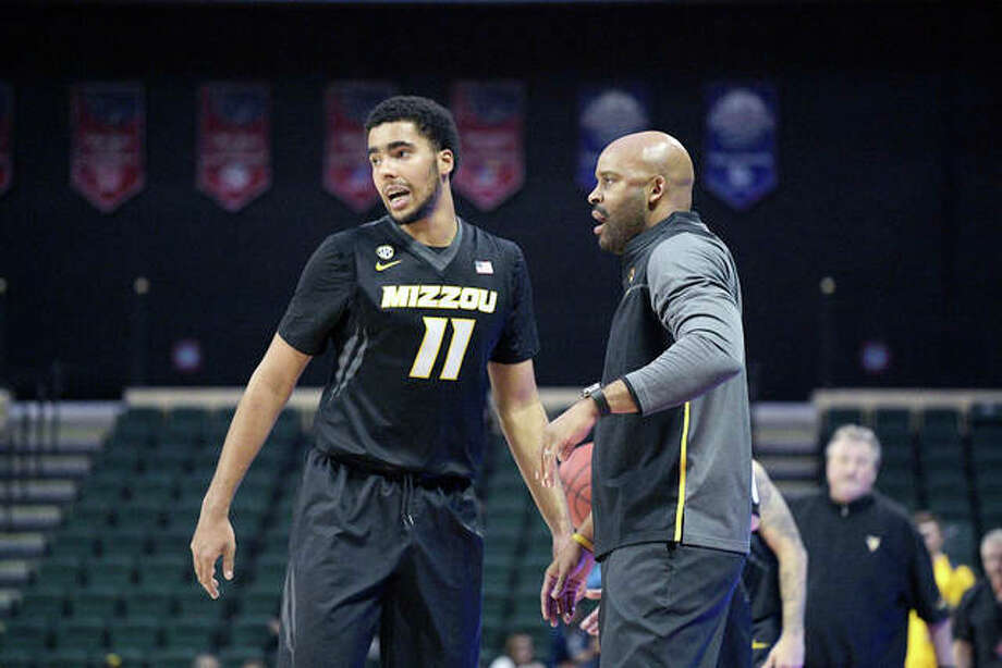 Missouri coach Cuonzo Martin, right, gives instructions to forward Jontay Porter (11) during a game last season against West Virginia at the finals of the AdvoCare Invitational tournament in Lake Buena Vista, Fla. Porter returned to Missouri this season in the hopes of helping the Tigers to back-to-back NCAA Tournaments, but is out for the season after a knee injury in a preseason scrimmage. Photo: AP Photo