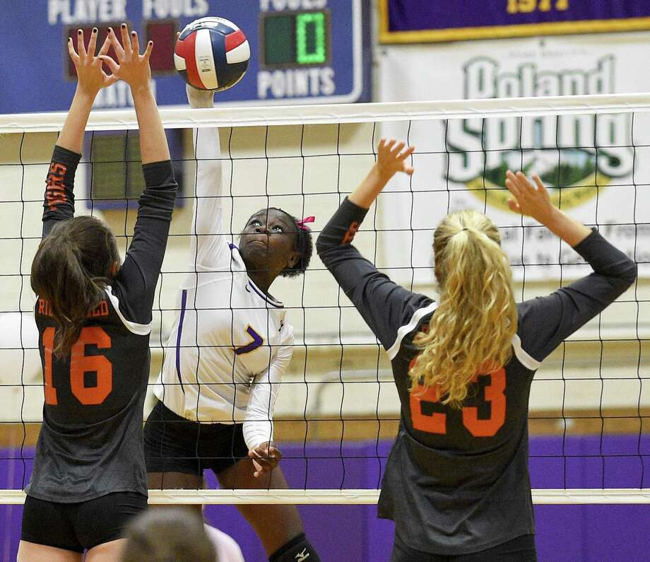 Westhill's Gloria Twum (7) spikes the ball past Ridgefield's Julia Kocsis (16) and Kate Garson (23) in a varsity girls volleyball match on Wednesday, Oct. 24, 2018 in Stamford, Connecticut. Westhill swept Ridgefield in three sets (25-20, 25-11, 25-22) improving their record to 17-2 over all. Photo: Matthew Brown / Hearst Connecticut Media / Stamford Advocate