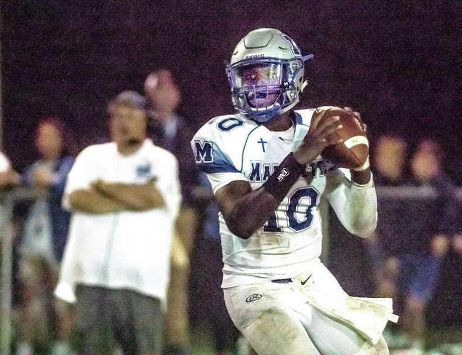 Marquette quarterback Kaleb Ware, shown in action this season against Civic Memorial, is one seven seniors the Explorers will lose to graduation. Photo: Telegraph Photo