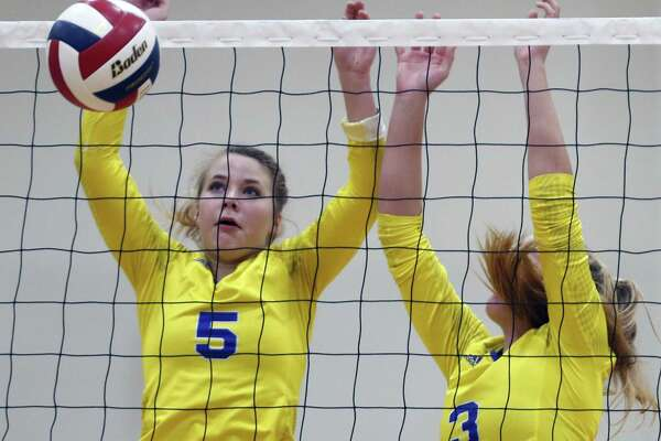 Clemens' Cassidy Steadman,5 and Ashley Breu combine to block a slam from the District 26-6A high school volleyball match between Clemens and New Braunfels Canyon on Tuesday, October 9, 2018