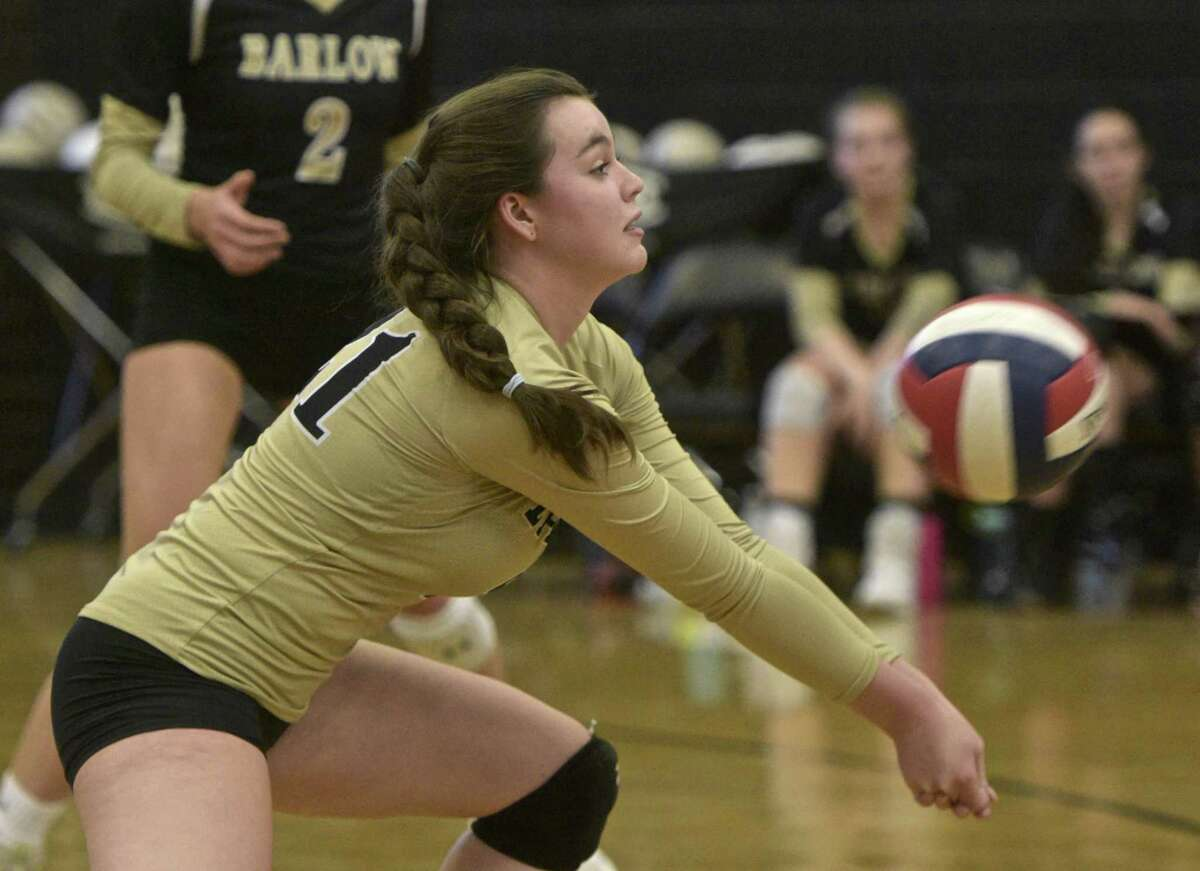 Barlow's Scotland Davis (21) digs out a serve in a girls volleyball game between Newtown and Joel Barlow high schools, Wednesday, October 24, 2018, at Joel Barlow High School, Redding, Conn.
