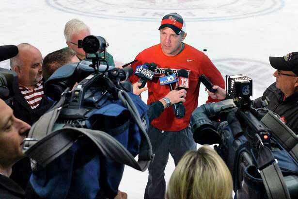 RPI head coach Dave Smith, center, speaks with reporters during RPI hockey media day Wednesday Oct. 3, 2018 in Troy, NY. (John Carl D'Annibale/Times Union)