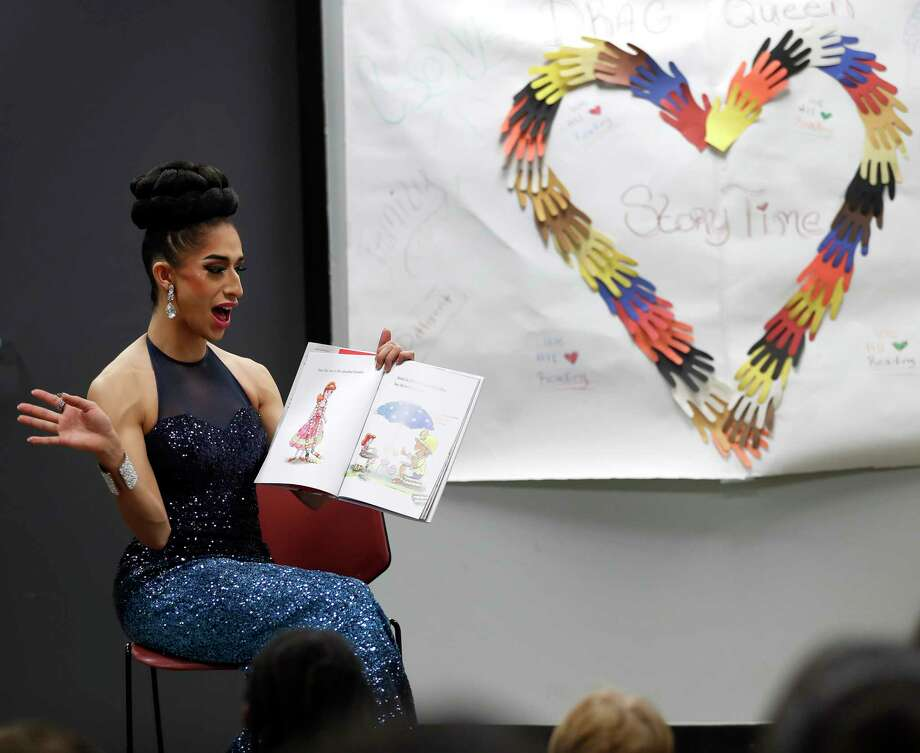 Angelina reads a book to children during the monthly Drag Queen Story Time at Freed-Montrose Neighborhood Library, Saturday, September 29, 2018, in Houston.  Photo: Karen Warren, Staff Photographer / © 2018 Houston Chronicle