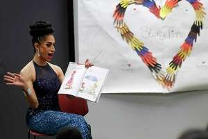 Angelina reads a book to children during the monthly Drag Queen Story Time at Freed-Montrose Neighborhood Library, Saturday, September 29, 2018, in Houston. Saturday marked the one-year anniversary of the story hour, which happens on the last Saturday of every month.