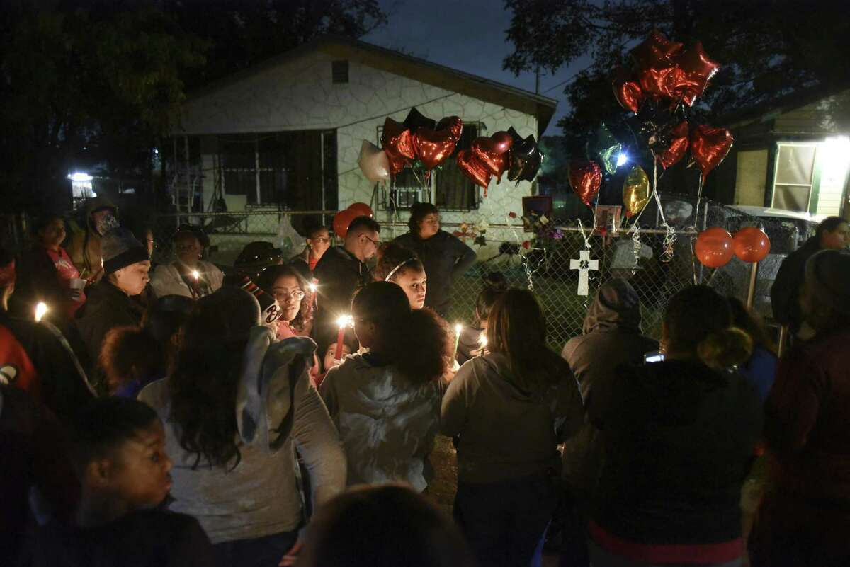 Friends and family of Charles Roundtree, an 18-year-old who was shot and killed by San Antonio police early Wednesday in the 200 block of Roberts Street, gather to memorialize him on Wednesday night, Oct. 17, 2018. Roundtree was unarmed and was struck by a bullet fired at another person.