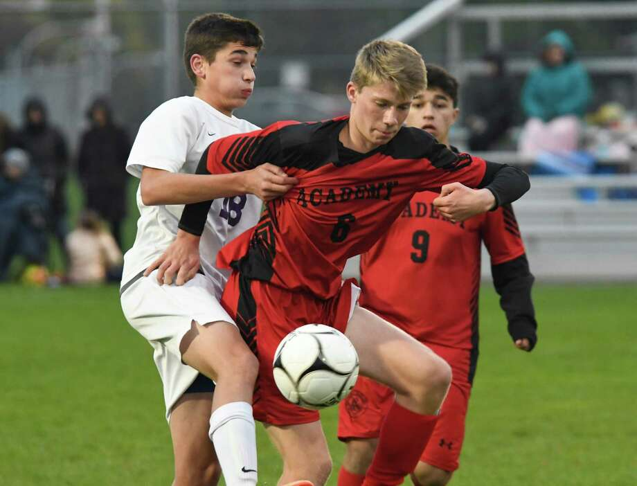Albany Academy's Jackson Foley-Stevenson gets in front of Ballston Spa's Brandon Maiello as Maiello knees the ball during their Class A sectional semifinal at South Colonie High School on Wednesday, Oct. 24, 2018, in Colonie, N.Y. (Jenn March, Special to the Times Union) Photo: Jenn March / © Jenn March 2018 © Albany Times Union 2018