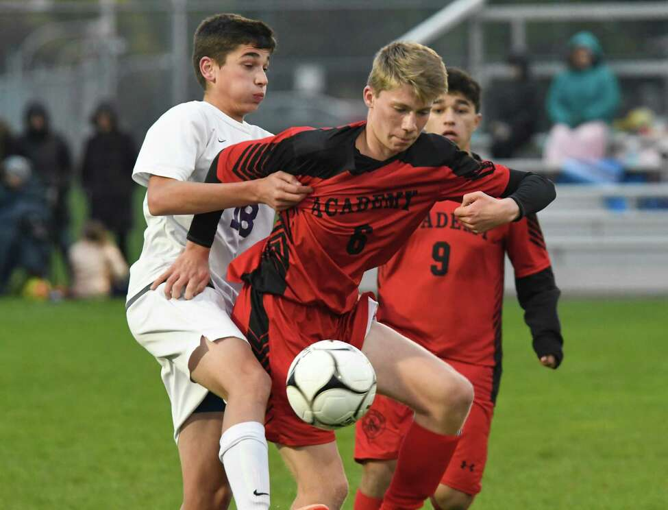 Albany Academy's Jackson Foley-Stevenson gets in front of Ballston Spa's Brandon Maiello as Maiello knees the ball during their Class A sectional semifinal at South Colonie High School on Wednesday, Oct. 24, 2018, in Colonie, N.Y. (Jenn March, Special to the Times Union)