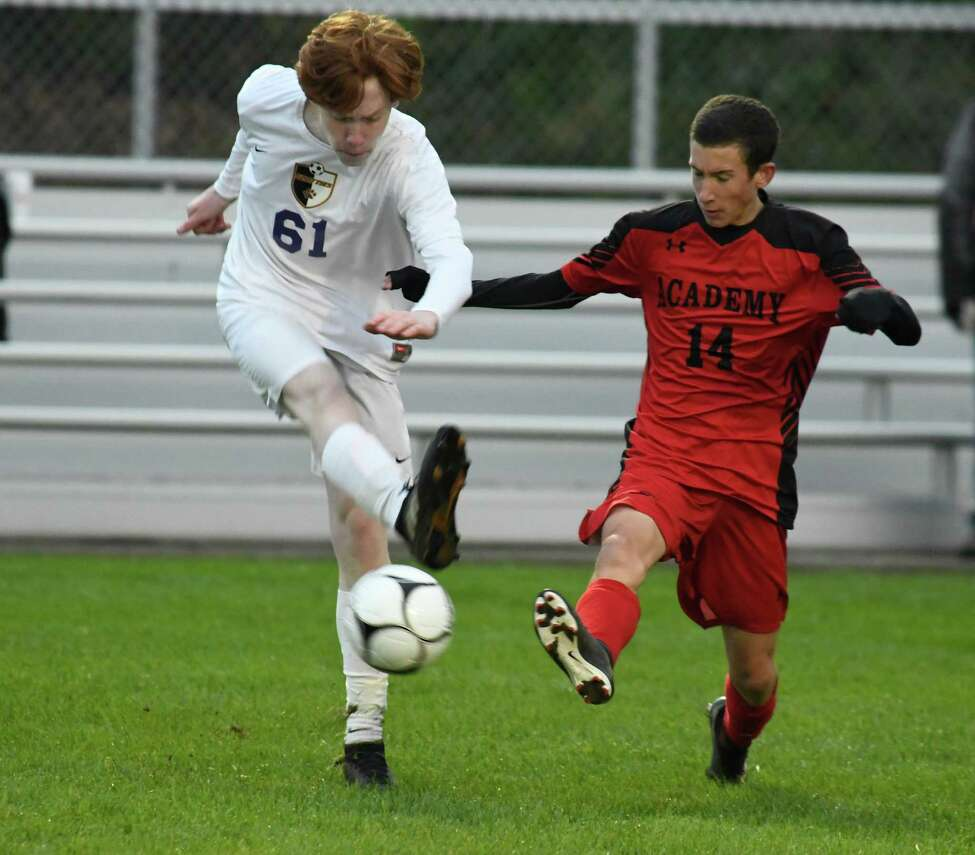 Albany Academy's Joshua Mitchell attempts to stop a pass by Ballston Spa's Justin Waters during their Class A sectional semifinal at South Colonie High School on Wednesday, Oct. 24, 2018, in Colonie, N.Y. (Jenn March, Special to the Times Union)